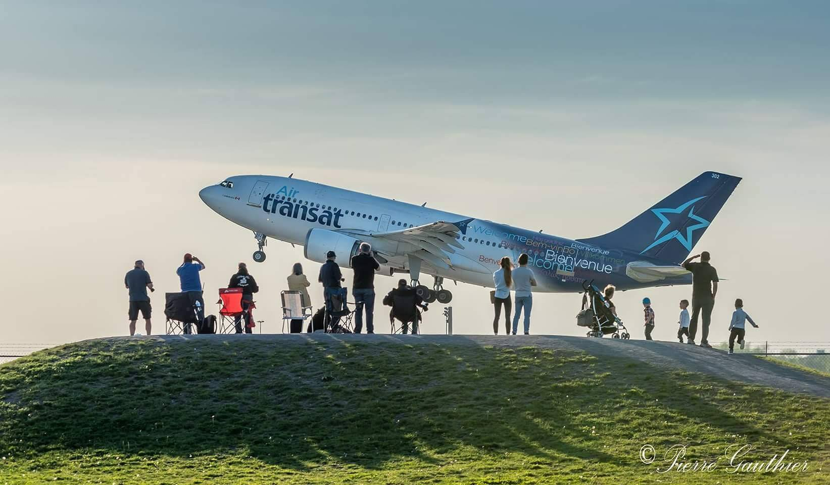Air Transat Airbus A310 taking off from runway 24L out of Montreal-Pierre Elliott Trudeau International Airport. Photo submitted by Pierre Gauthier