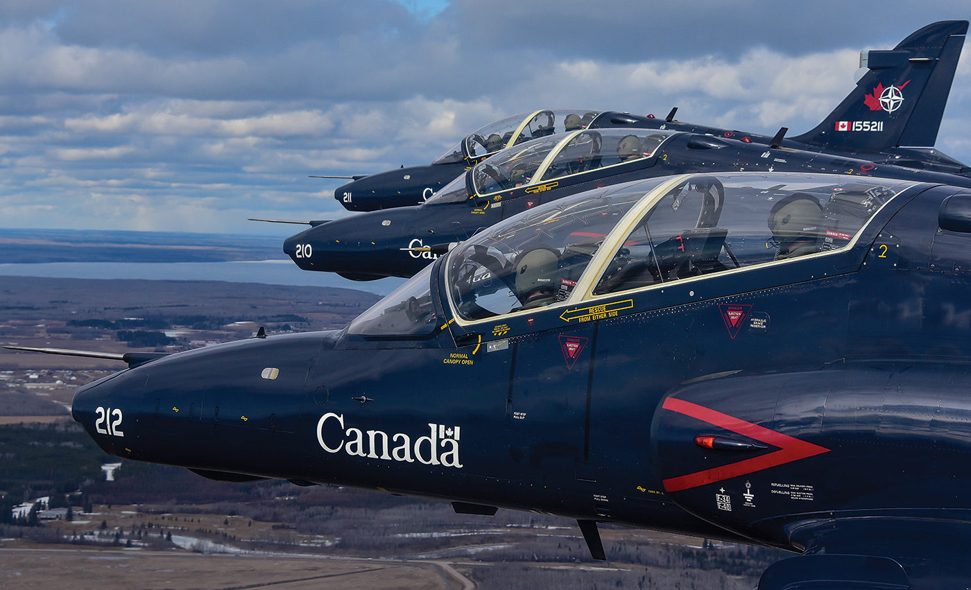 Three CT-155 Hawks in flight