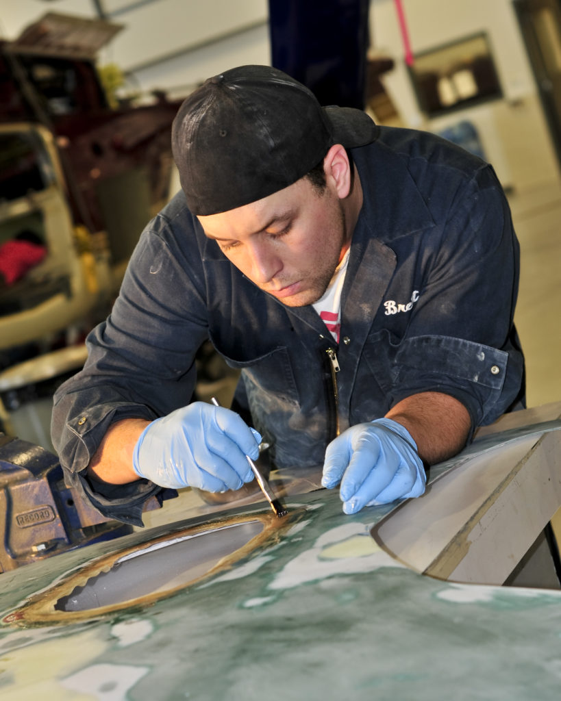 Maintenance worker works in shop