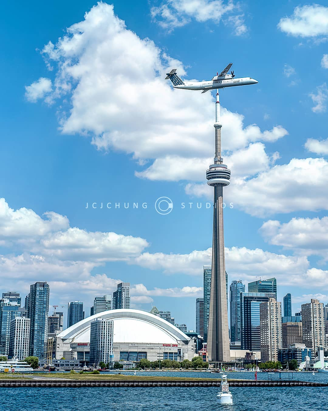 A Porter Airlines Bombardier Q400, with the Toronto skyline as a backdrop. Photo submitted by John Chung (Instagram user @jcjchung) using #skiesmag