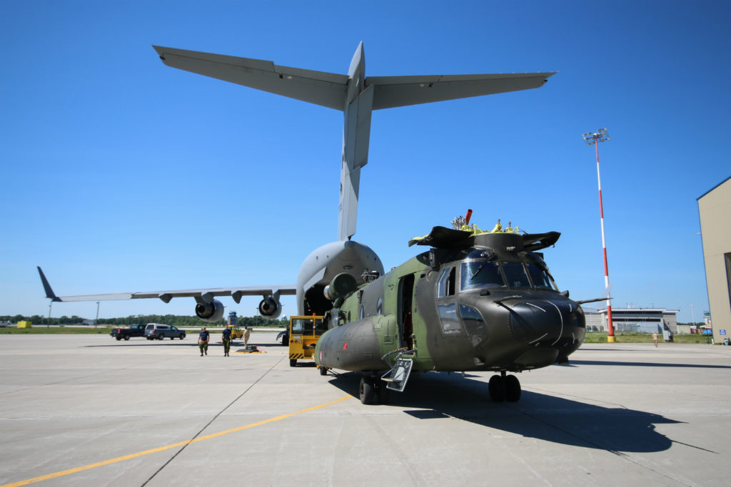 Chinook with rotors removed sits in front of Globemaster