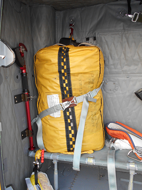 The life raft was secured inside the helicopter by a lap belt. RCAF Photo