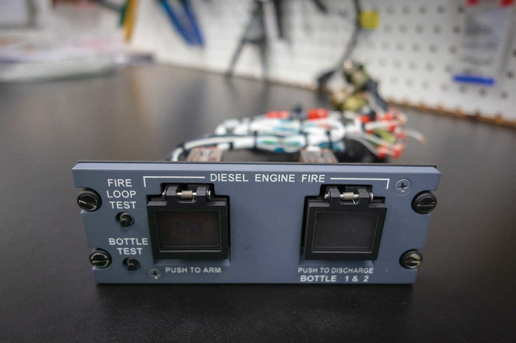 Aeronav is in the midst of a 2.5-year project known as the Boeing 737 conversion program, which involves creating environmental disaster relief air tankers. The company has finished the wiring on this fire control panel for the diesel engine pump of a 737 aircraft. Heath Moffatt Photo