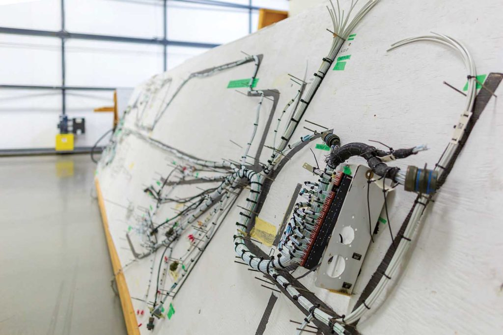 A wire bus board for an MD 500, which Aeronav can rewire from tip to tail in four to six weeks. Heath Moffatt Photo