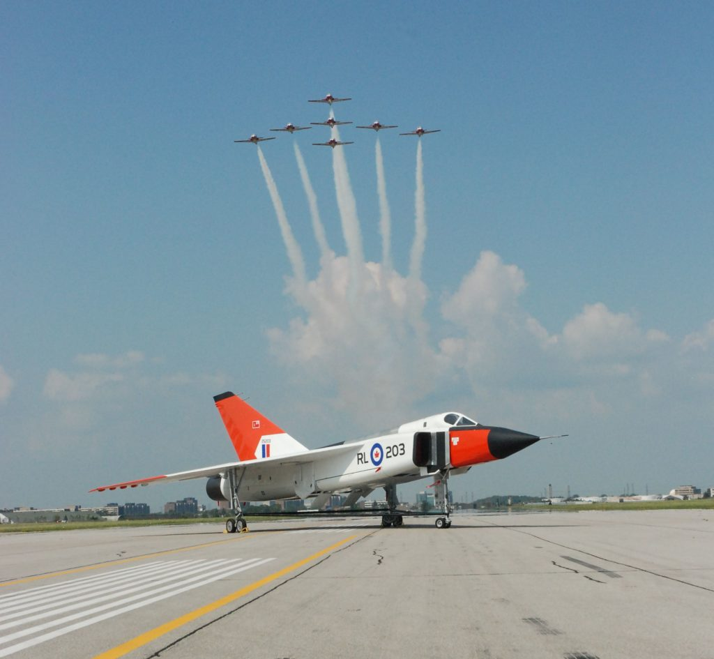 Pictured is a full-scale replica of the Avro Arrow at Downsview Airport with Canadian Forces Snowbirds flying in formation in the background. Ken Swartz Photo
