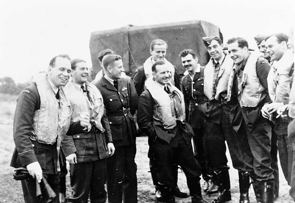 Battle of Britain pilots on Oct. 24, 1940: (left to right) flying officer W.P. Sprenger, flying officer O.J. Peterson, flying lieutenant W.R. Polloch, flying officer P.B. Pitcher, squadron leader E.A. McNab, flying officer P.W. Locknan, flying lieutenant E.M. Reyno, flying officer Beardmore, flying officer S.T. Blaihloch (intelligence officer) and flying officer R.W. Norris. DND Photo