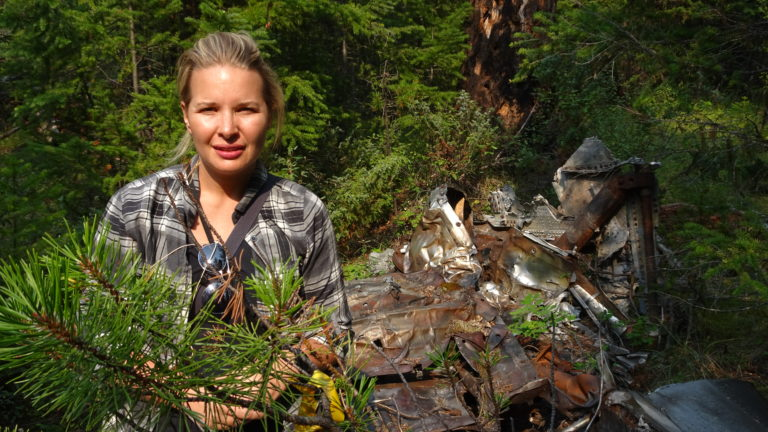 Johanna Wagstaffe, a CBC journalist and private pilot, stands near the wreckage of CP Flight 21 during a recent visit to the crash site. CBC Photo