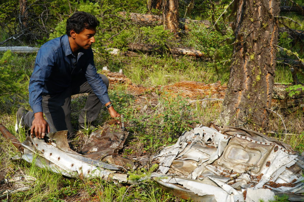 Ian Hanomansing, co-host of CBC's The National and Uncover: Bomb on Board, inspects the wreckage. CBC Photo