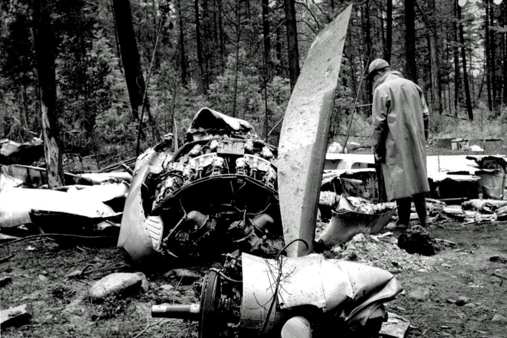 An investigator surveys the wreckage of Canadian Pacific Flight 21, which crashed after a bomb exploded on board on July 8, 1965. All 52 people on board died in the incident. Transport Canada Photo