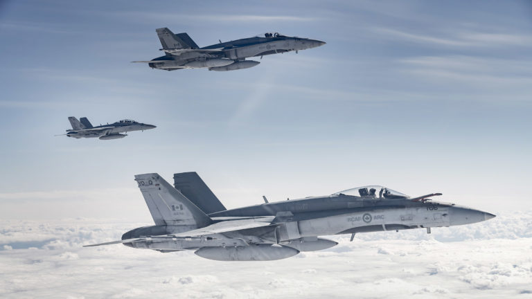 From top to bottom: An RCAF CF-188 Hornet from 425 Tactical Fighter Squadron, a United States Navy EA-18G Growler, and an RCAF CF-188 Hornet from 401 Tactical Fighter Squadron fly the skies over Alberta on June 15, 2018, during Exercise Maple Flag 51.