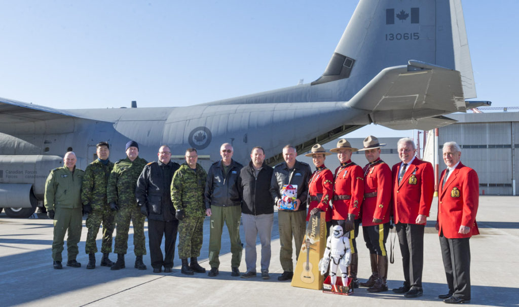 Members of the RCMP and RCAF combined forces to bring toys to remote northern communities in Canada. They gathered for a photo before departing from 8 Wing Trenton, Ont., on Dec. 7, 2018. Leading Seaman Dan Bard Photo