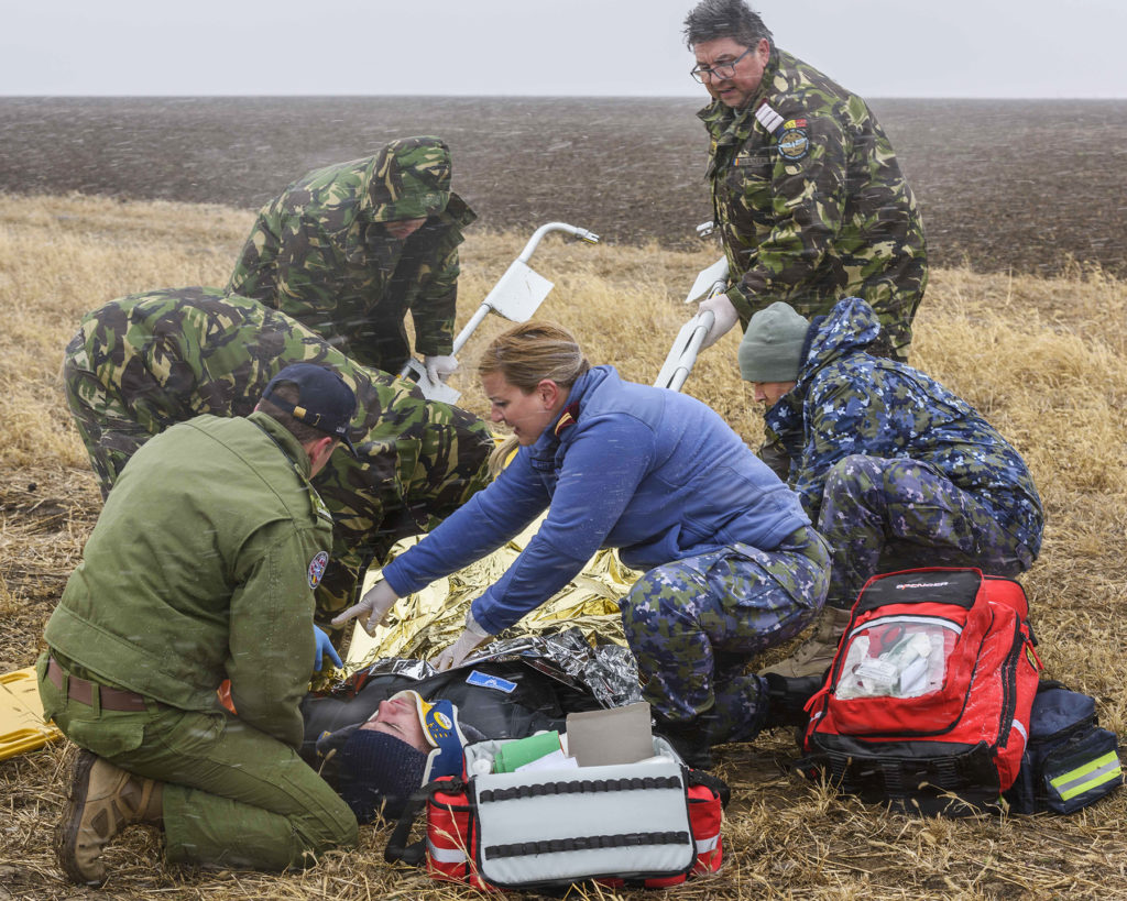 Canadian and Romanian military medical teams participate in a CF-188 Hornet crash simulation exercise off Mihail Kogalniceanu Air Base in Romania during Operation Reassurance on Nov. 16, 2018. Cpl Dominic Duchesne-Beaulieu Photo