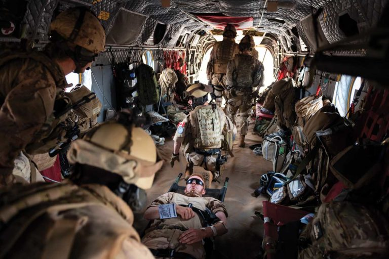 For the medevac mission, the Chinooks are equipped with a specially designed wet floor that contains bodily fluid spills to prevent aircraft corrosion. Lloyd Horgan Photo