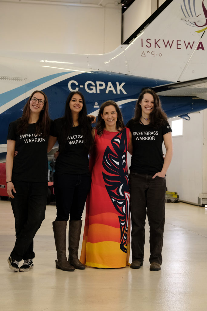 Iskwew Air CEO Teara Fraser (third from left) stands with the airline's all-female maintenance crew. Iskwew Air Photo
