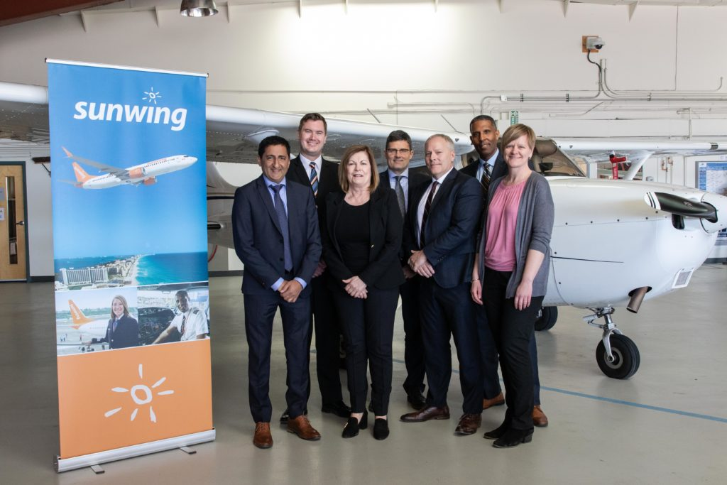 From left to right: Piyush Gandhi, vice-president of flight operations for Sunwing Travel Group; Jeff Binks, Sunwing captain; Elizabeth Evans, dean of Mount Royal University's Faculty of Business and Communication Studies; Shane Workman, senior director of flight operations for Sunwing Travel Group; Michael Simmons, Sunwing assistant chief pilot; and Deanna Wiebe, aviation program chair for Mount Royal University.
