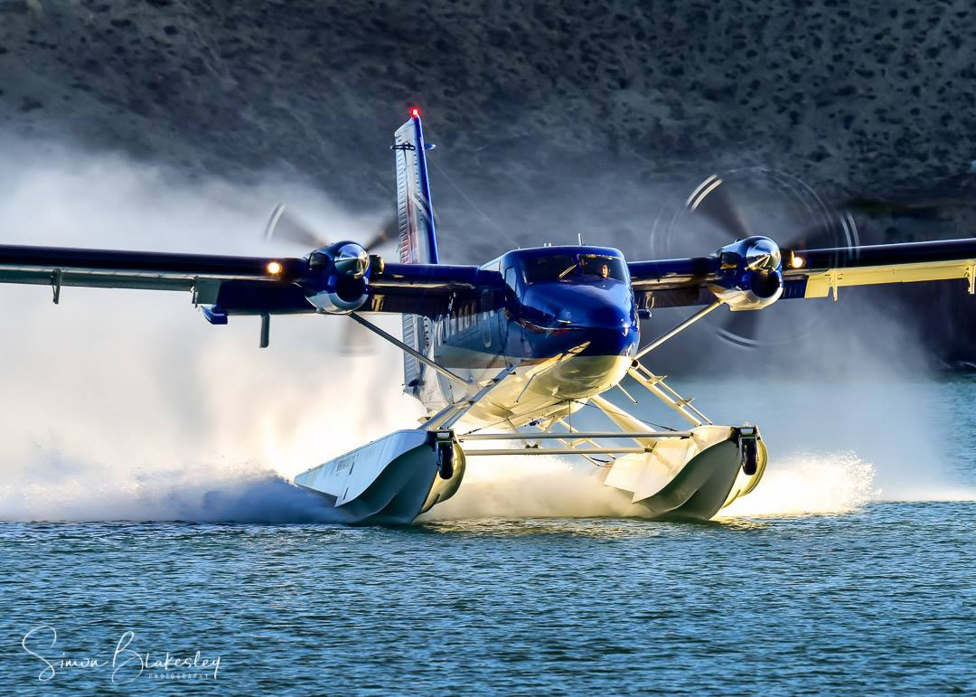 Viking Air Ltd.'s Series 400 Twin Otter makes a scene departing from Schwatka Lake, Yukon. Photo submitted by Simon Blakesley (Instagram user @simon_blakesley) using #skiesmag
