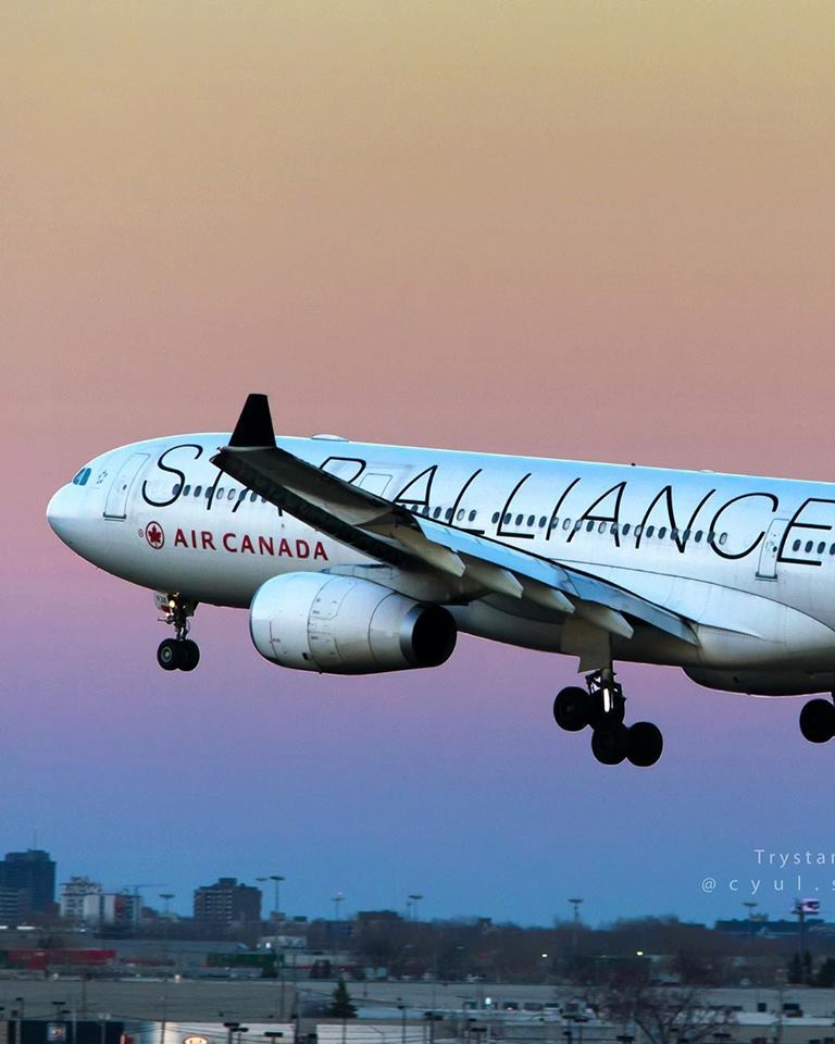 An Air Canada Airbus A330-300 in Star Alliance livery takes off from YYZ in clear rainbow-coloured skies. Photo submitted by Trystan Dupré (Instagram user @cyul.spotter) using #skiesmag