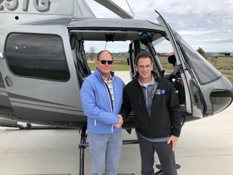 Ted Groesbeck (left) stands with Rob Tyler of Heli-Lynx in front of Groesbeck's new custom VIP H125 helicopter. Oliver Johnson Photo