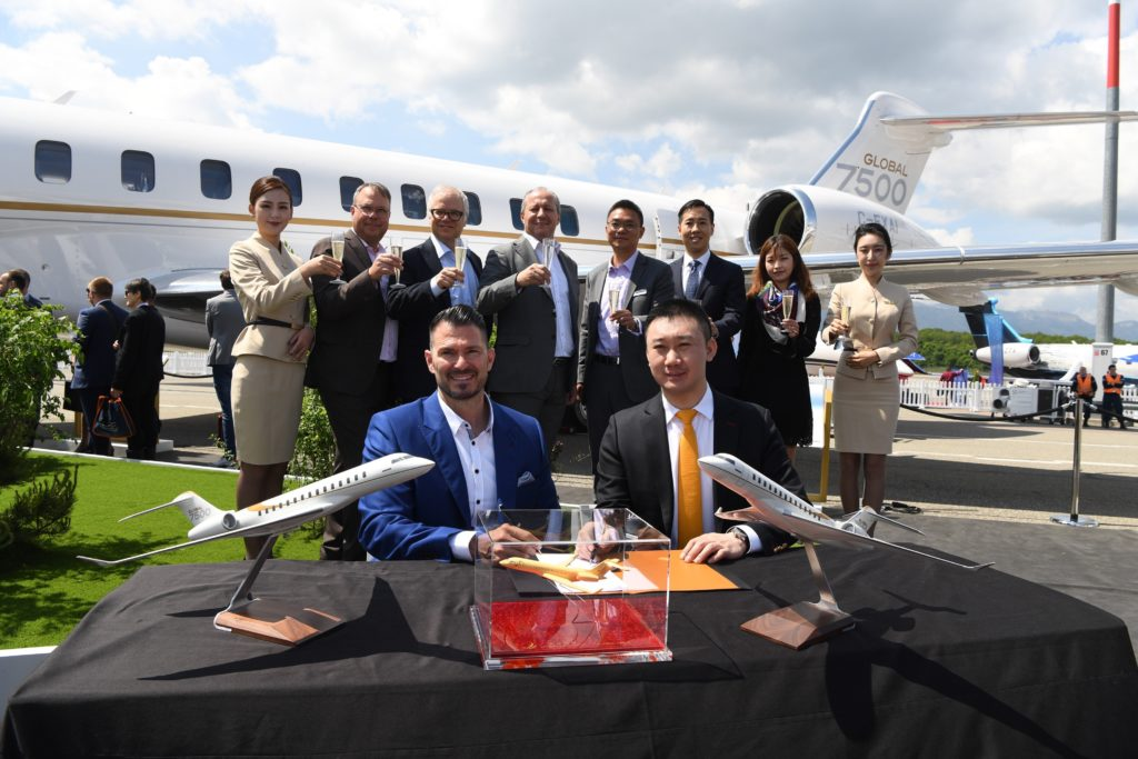 From left to right: David Coleal, president, Bombardier Aviation and HK Bellawings' President, YJ Zhang after signing the deal at EBACE 2019 in Switzerland. Bombardier Photo