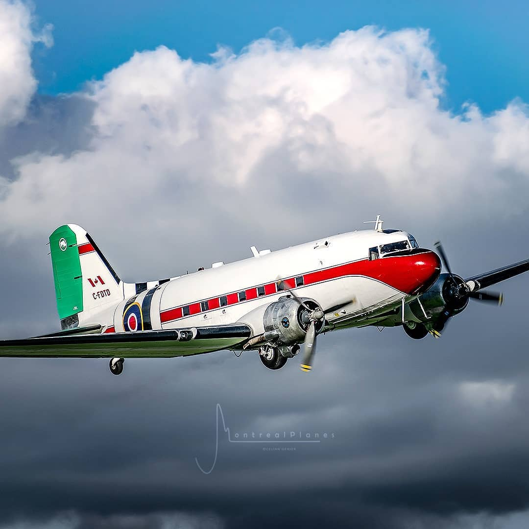 The gorgeous DC-3 of Plane Savers fame painted in its D-Day invasion stripes on the 75th anniversary of that fateful day. Photo submitted by Instagram @montreal.planes using #skiesmag.