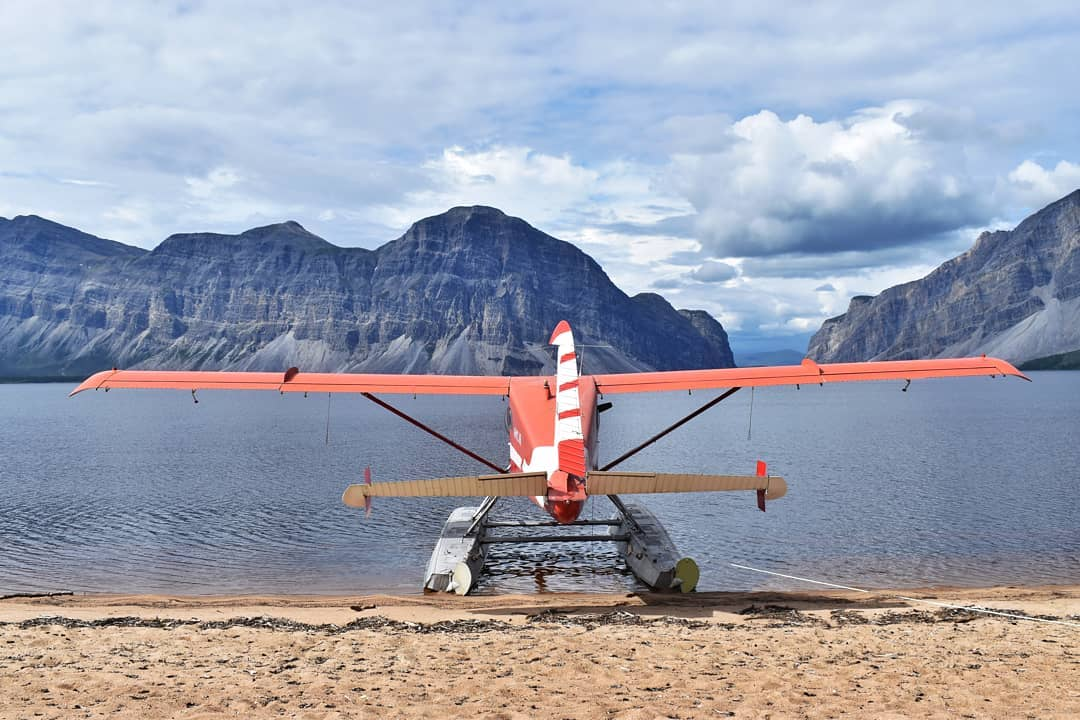 A DHC-2 Beaver sits idle, staring down Little Doctor Lake, the gateway to the Nahanni National Park. Photo submitted by Instagram user @ahmicair using #skiesmag.