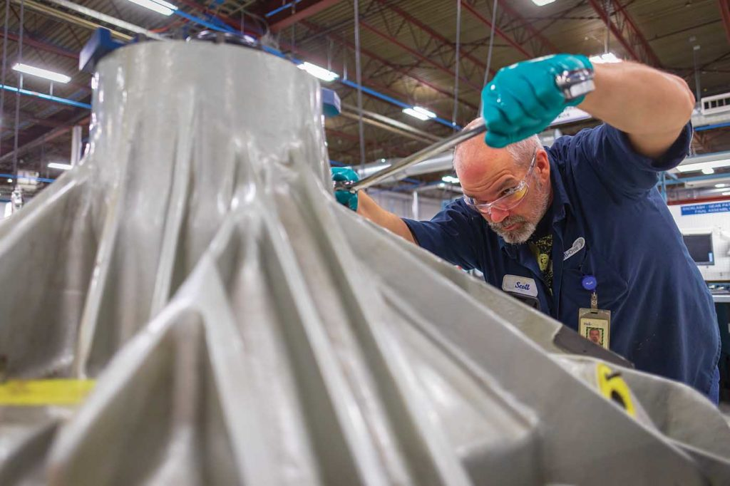 Component technician Scott Richardson performs fluid fitting on an S-76 main gearbox. Heath Moffatt Photo