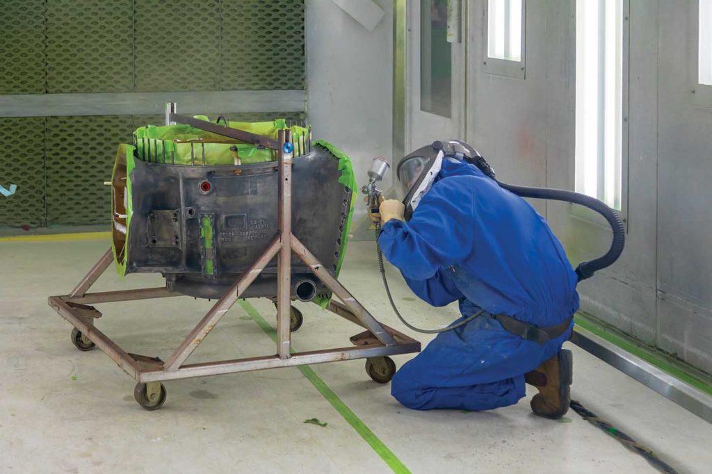 Aircraft painter Devon Hunter applies Rockhard coating to a Sikorsky S-61 gearbox. Heath Moffatt Photo