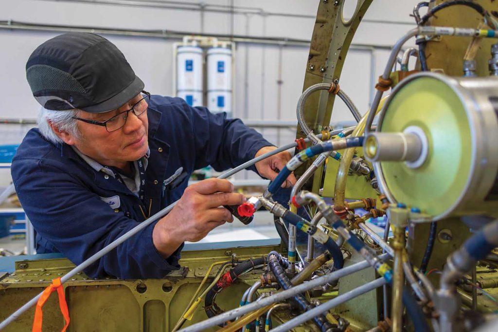 AME Clemente Samson performs an inspection on an S-76. Heath Moffatt Photo
