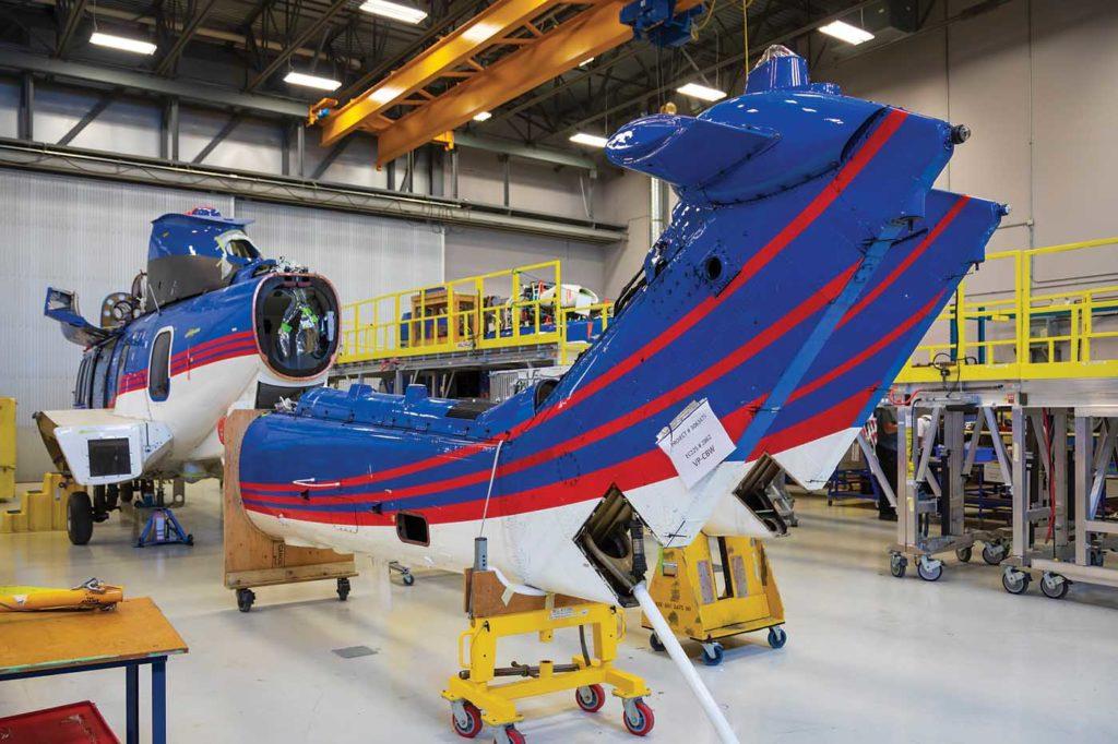 H225 tail assemblies sit behind the main airframe in the Heli-One hangar. Heath Moffatt Photo