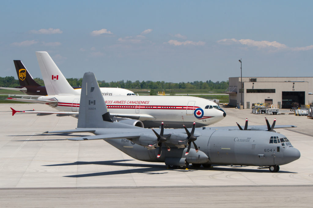 A 437 Squadron CC-150 Polaris and one of two 436 Squadron CC-130J Hercules await their crews for the 75th Anniversary of D-Day flypast at Canadian Warplane Heritage Museum in Hamilton on June 6. Andy Cline Photo