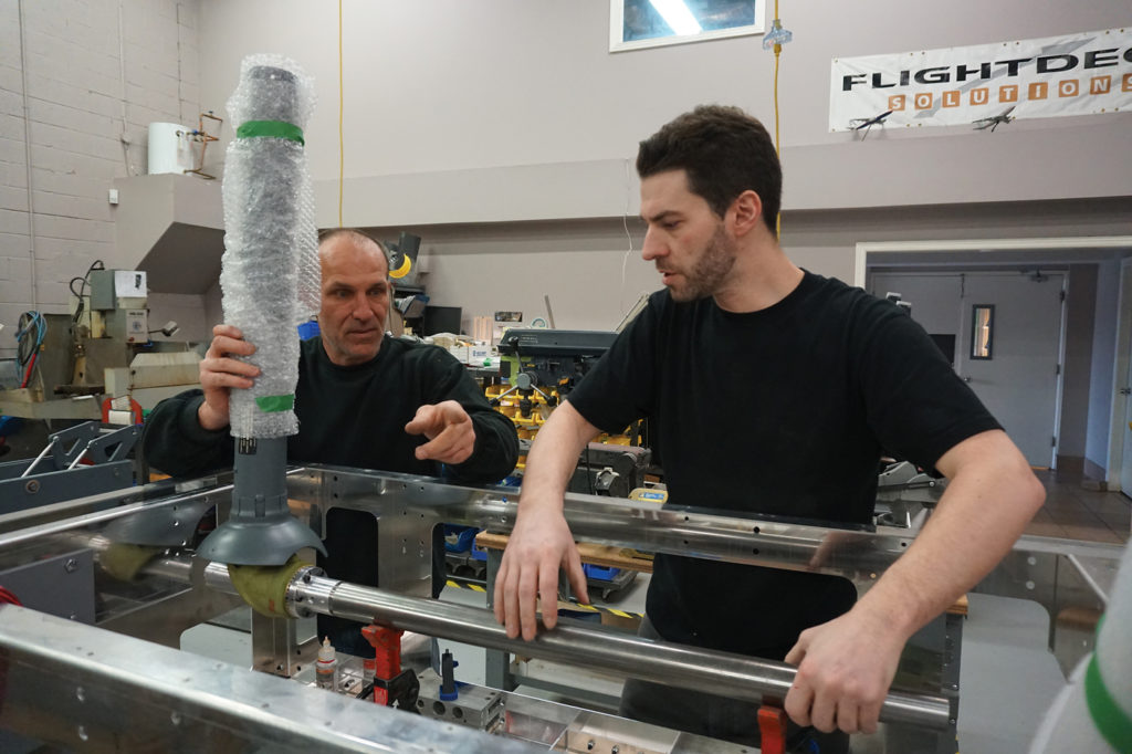 Bill and Scott integrate a real Boeing 737 yoke/column set into an FDS flight control box. Lisa Gordon Photo