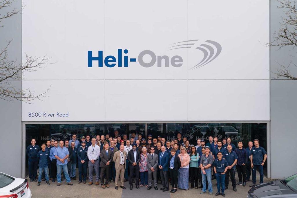 Heli-One recently hosted Harjit Sajjan (front, center), Canada's defense minister, at its facility in Vancouver. The company hopes to bolster its business with an increasing amount of military and government support work in the future. Heli-One Photo