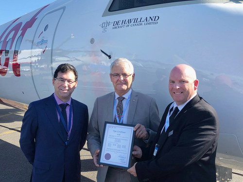 David Curtis, chairman and CEO Longview Aviation Capital, Marc Garneau, Minister of Transport, and Todd Young, chief operating officer, De Havilland Aircraft of Canada celebrate De Havilland Canada formally receiving the type certificates for the entire Dash 8 aircraft program. De Havilland Aircraft Photo