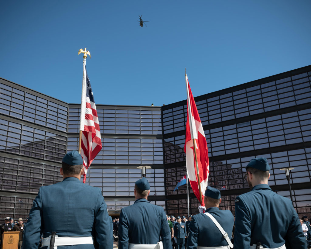 A CH-146 Griffon helicopter from 408 Tactical Helicopter Squadron flies over 1 Canadian Air Division headquarters during the change of command ceremony for 1 Canadian Air Division, Canadian NORAD Region and the Joint Force Air Component. RCAF/Avr Tanner Musseau-Seaward Photo