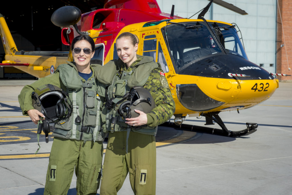 HCol Kendra Kincade (left) and Maj Alexia Hannam, commanding officer of 417 Sqnadron, standing by a CH-146 Griffon Helicopter of 417 Squadron. RCAF Photo