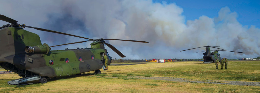 CH-147 Chinooks and CH-146 Griffons standby at Williams Lake Airport for a possible evacuation of the Williams Lake region during Operation Lentus in British Columbia in 2017. Cpl Gabrielle DesRochers Photo