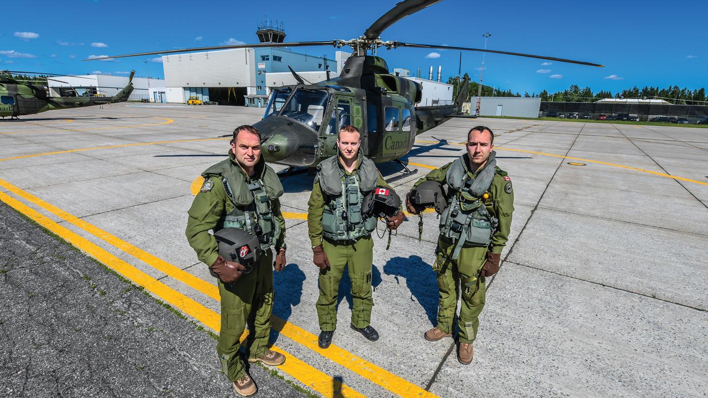 Left: Maj Mathieu Bertrand, Aircraft Commander / DCO 430 ETAH; Capt Jeremiah Eastwoord, First Officer, Right; Cpl Miguel Sigouin, Flight Engineer. Mike Reyno Photo