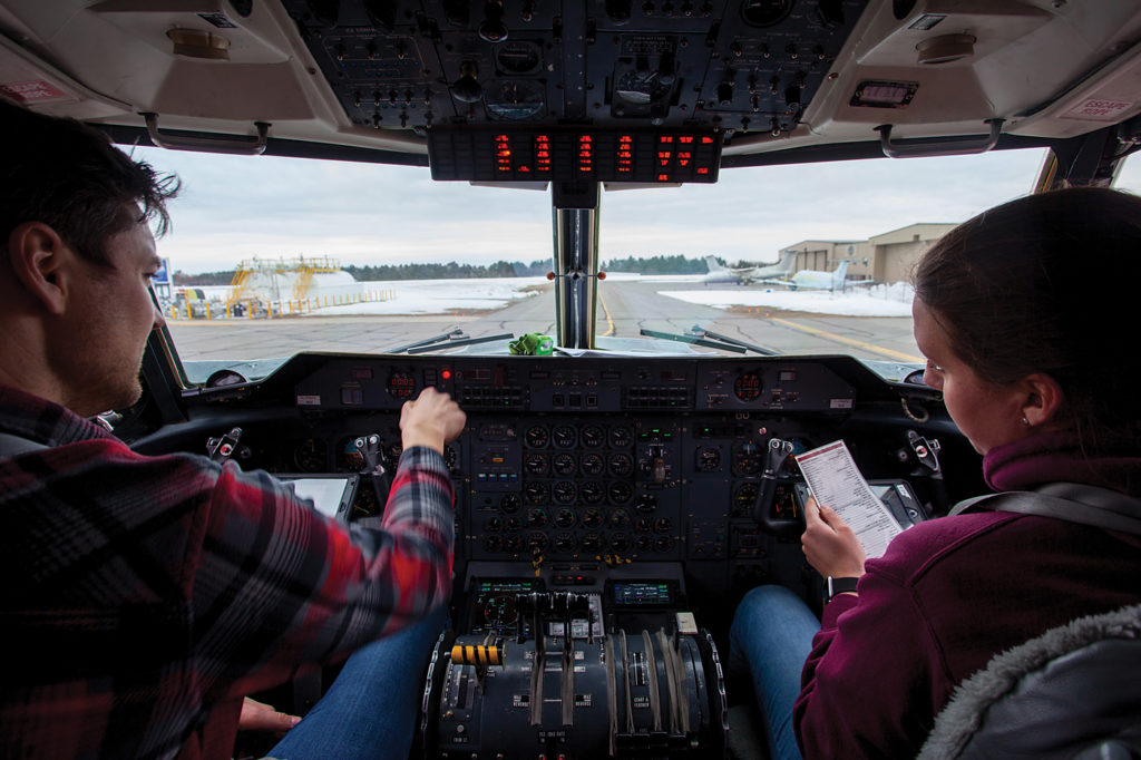 Air Tindi pilots Ted Duinker and co-pilot Nicole Rose preflight Dash 7 C-FWZV at Muskoka Airport in Ontario, in preparation for the return flight to Yellowknife. The aircraft was in for a respray at Muskoka Aircraft Refinishing's paint shop in March 2019. Andy Cline Photo