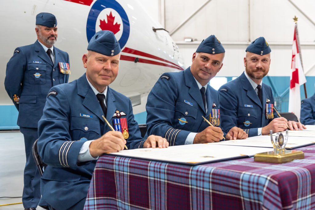 LCol Merilainen (left) during the ceremony, joined by Col Deming (centre) and LCol Snow (right), who Merilainen is replacing as commanding officer of 412 Transport Squadron. RCAF Photo