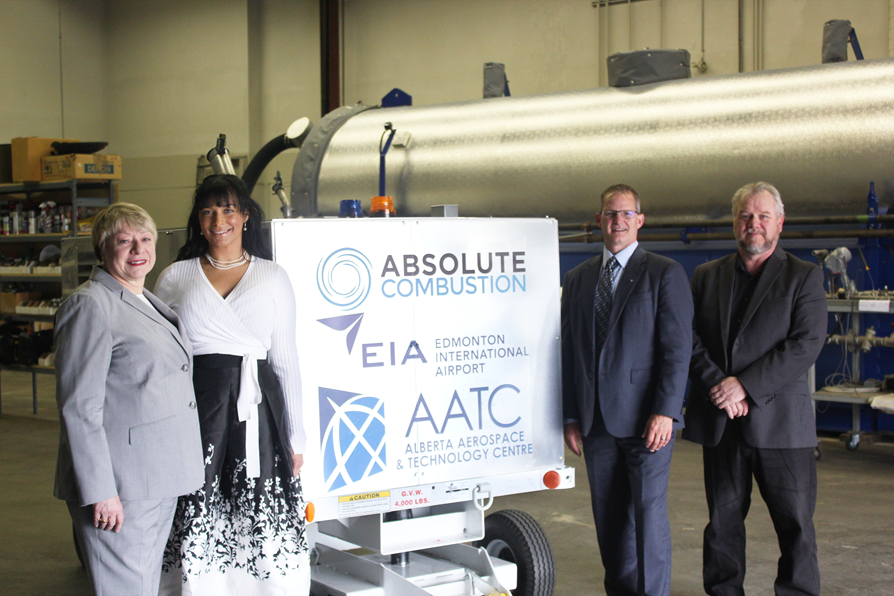 Laura Kilcrease, CEO of Alberta Innovates, Koleya Karringten, CEO of Absolute Combustion International, Steve Maybee, VP of Operations and Infrastructure, Edmonton International Airport and Rollie Dykstra, VP of Investments, Alberta Innovates, pose in front of the new Absolute Combustion International-SM1000 portable aircraft heater, tested and produced in Alberta. Edmonton International Airport Photo