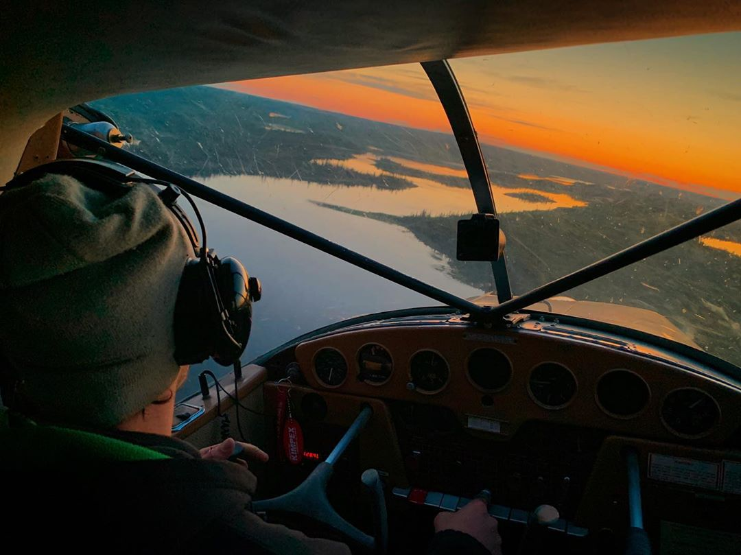 Midnight sun flying in the cockpit of a Cessna 170 in the skies above Yellowknife. Photo submitted by David England (Instagram user @dave_england_) using #skiesmag.