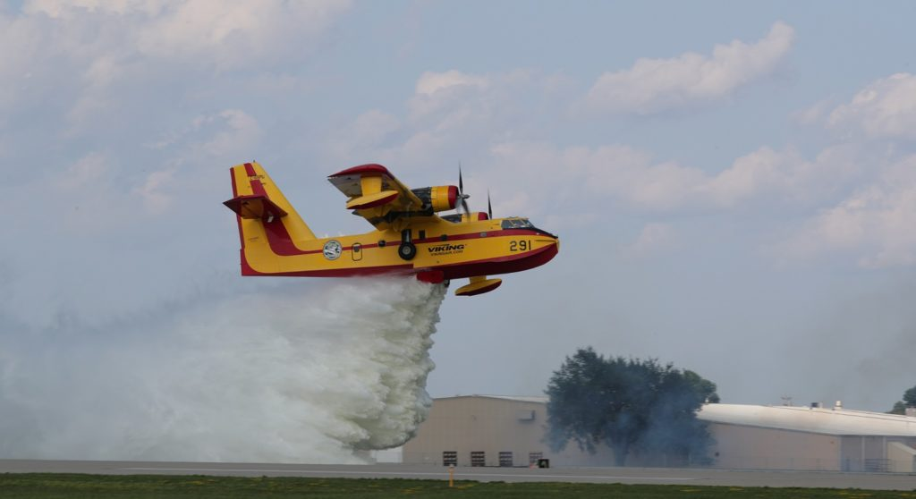 Viking Aircraft's Canadair CL-215 was the star attraction in the daily aerial firefighting display, dropping two or three loads of water scooped from nearby Lake Winnebago. Warren Liebmann Photo