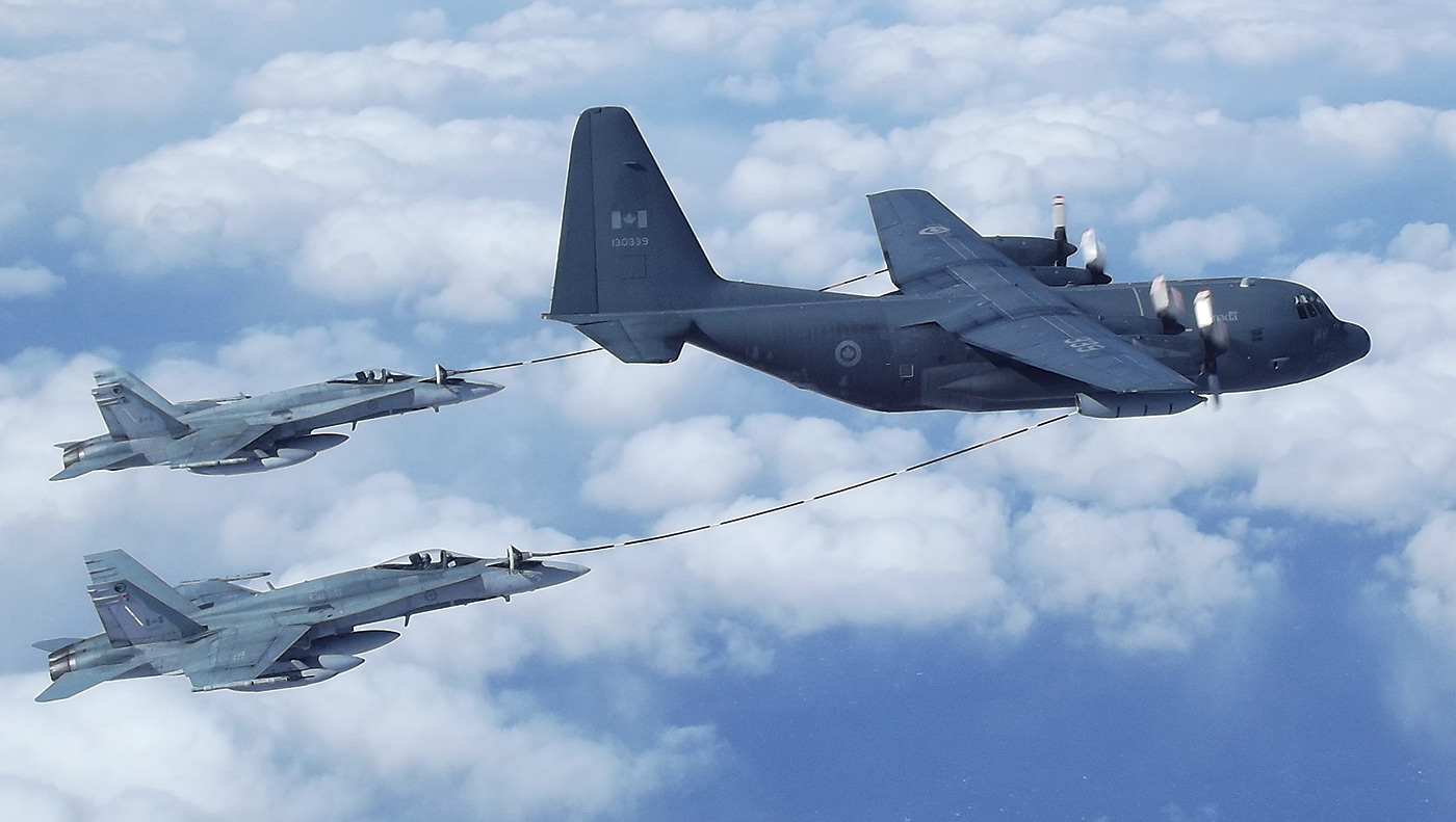Two CF-188 Hornets perform an air refuel with a CC-130T Hercules on a flight from Canada to Iceland in April 2011 to join Task Force Iceland in support of Operation Ignition. Sgt Dwayne Janes Photo
