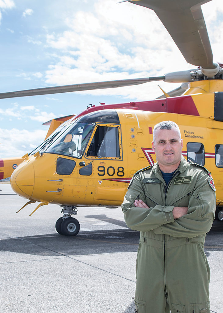 CWO Neil Thorne next to a CH-149 Cormorant at 19 Wing Comox, B.C. Cpl Jeffrey Clement Photo