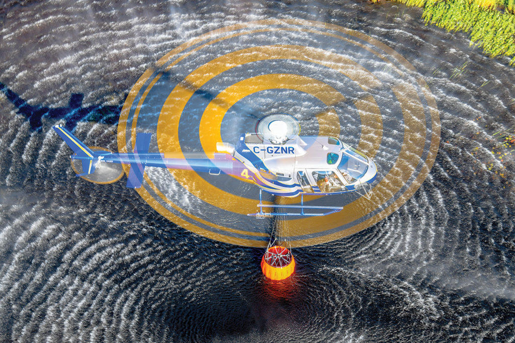 Filling a Bambi Bucket from a water source close to a fire can be critical to the efforts of the firefighting team. Mike Reyno Photo