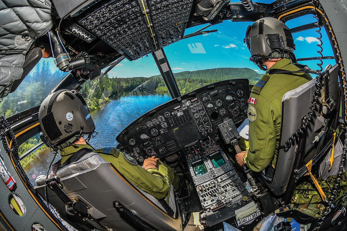 An RCAF crew from 430 Squadron flies a CH-146 Griffon helicopter near Valcartier, Que. While there are some regulatory and procedural differences, military pilots will undoubtedly find their years of service have prepared them well for civilian employment. Mike Reyno Photo