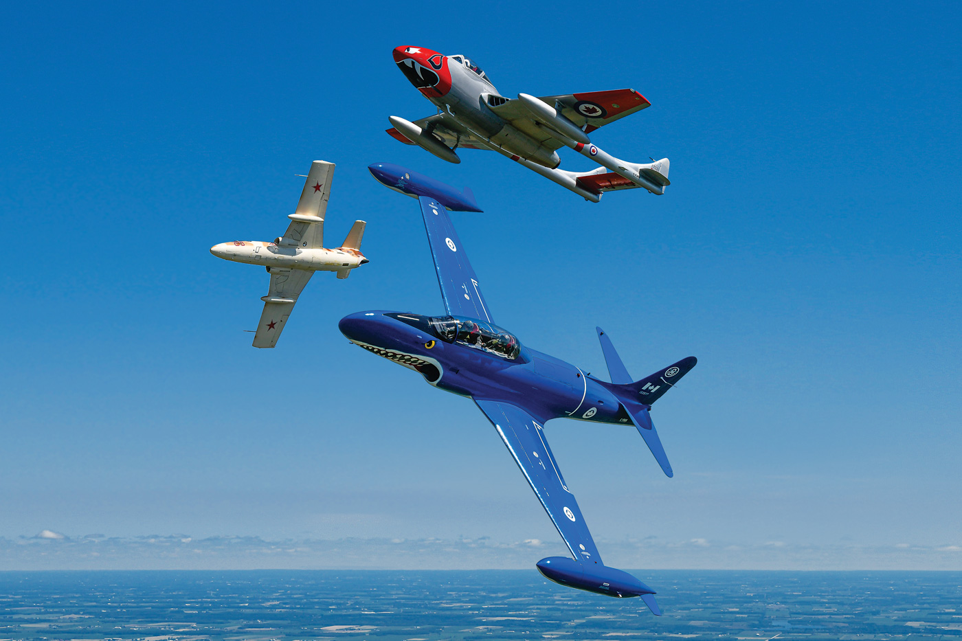 """Waterloo Warbirds aimed to make the paint schemes on each aircraft as eye-catching as possible -- such as the Ct-133's bright blue """"Mako Shark"""" livery (foreground). Mike Reyno Photo"""