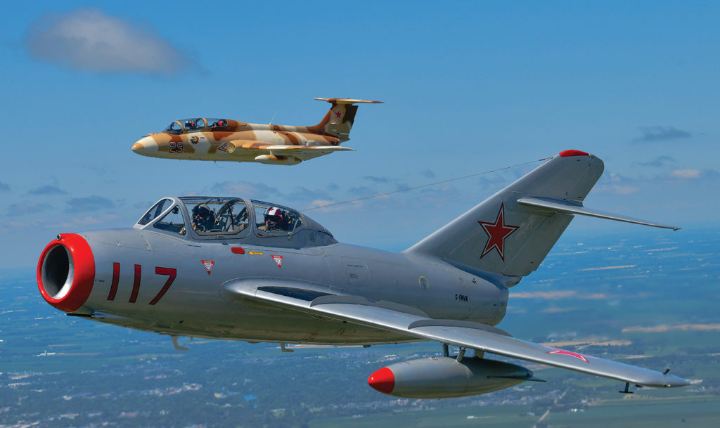 The Soviet aircraft -- the L-29 (background and MiG-15 -- have proved to be challenging for the maintenance crew. In some cases, they've had to reverse-engineer parts in the effort to keep the old jets operational. Mike Reyno Photo