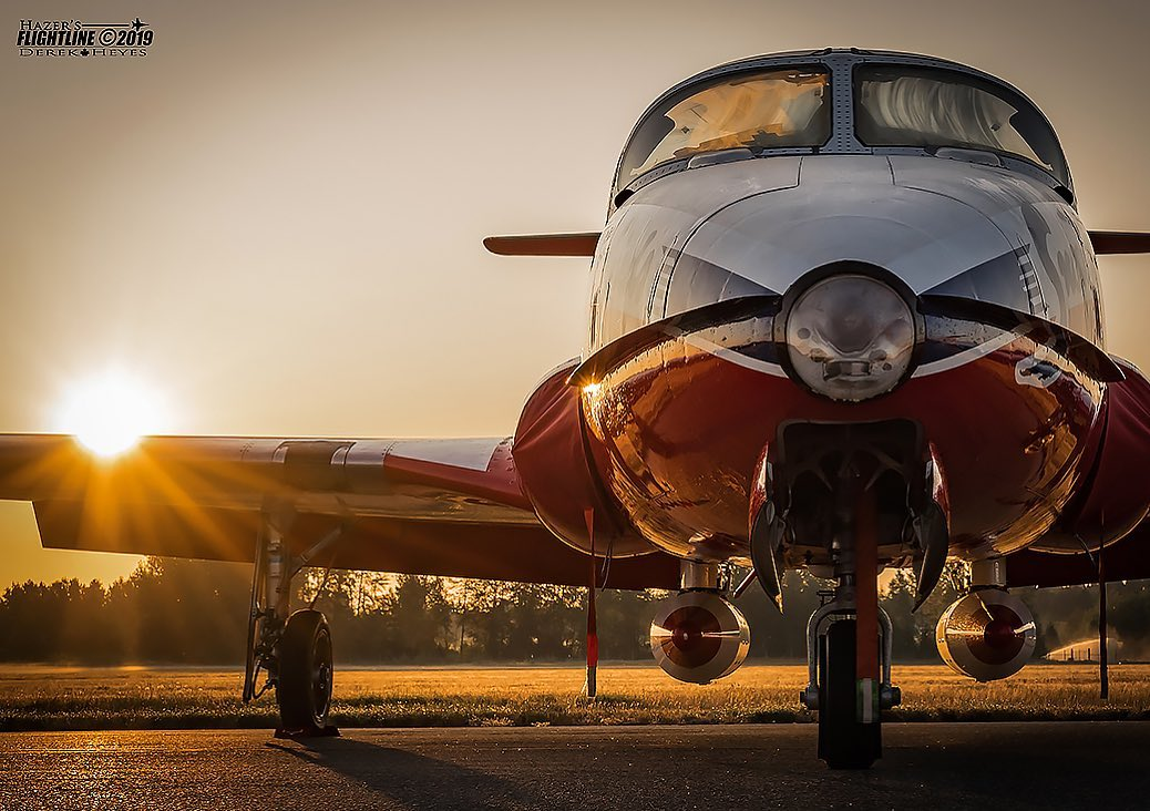 The morning sun rises above a Snowbirds' Tutor on a summer day at YCD Nanaimo Airport. Photo submitted by Derek Heyes (Instagram user @hazers_flightline) using #skiesmag.