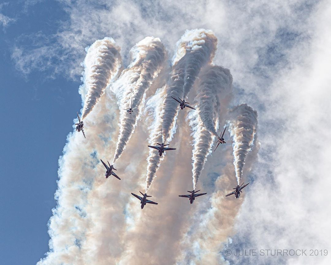The RAF Red Arrows let out a haze of white smoke as they perform during the AERO Gatineau-Ottawa 2019 airshow. Photo submitted by Julie Sturrock (Instagram user @juliesturrockyul) using #skiesmag.